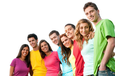 Bild vergrößern: Large group of smiling friends staying together and looking at camera isolated on white background